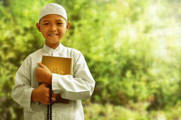 Asian muslim kid smiling