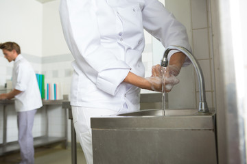 close-up of chef washing his hands