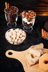 Unhealthy but delicous sweets and pastry on dark wooden background in studio photo