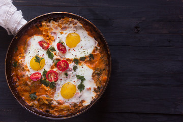 three fried eggs with сherry tomatoes