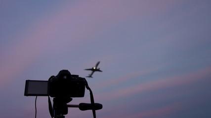 DSLR camera pointed at a jetliner taking off