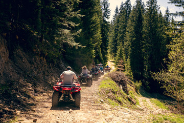 A tour group travels on ATVs and UTVs on the mountains Fotobehang
