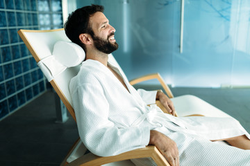 Portrait of handsome man relaxing in spa center