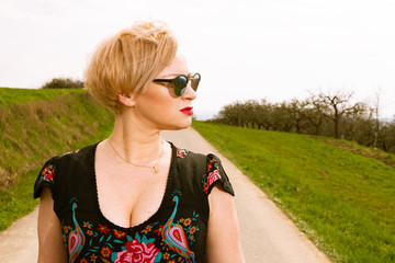 Portrait of cool fashionable woman wearing dress and shades.