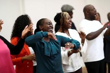 Members of the Kingdom Choir sing at Fresh Ground Church in Battersea, London