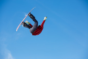 Photo of sportive man jumping with snowboard