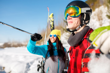 Photo of sports man and woman pointing forward walking on snow hill