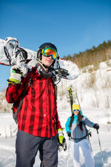 Photo of young man wearing helmet with snowboard