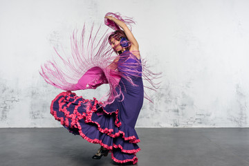 Flamenco dancer in action with the typical Spanish dance costume.