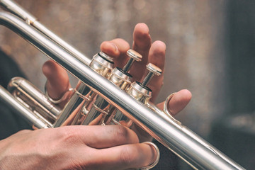 Hand of the Trumpeter on the buttons of trumpet
