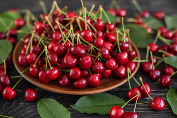 Tasty juicy sweet cherry on a wooden background. It can be used as a background Wall mural