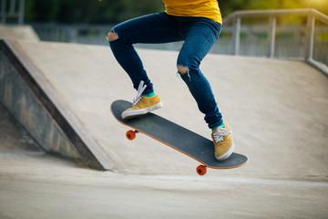 skateboarder skateboarding on skatepark ramp