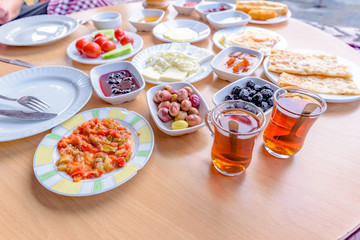Top view of traditional Turkish breakfast on wooden table
