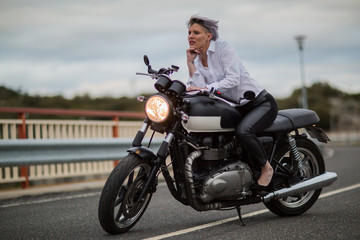 Attractive woman sitting on her motorbike