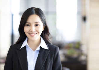 young business woman standing in the office