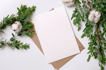 Kraft paper envelope with white card.