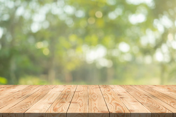 Empty wood table on blurred background copy space for montage your product or design,Blank brown board with abstract blurred background.