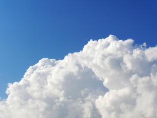 huge white cloud in the blue sky