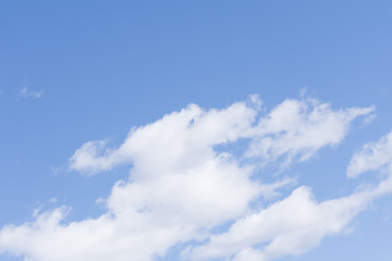 Pale cloudy sky background calm peaceful puffy .