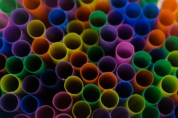 Colorful drinking straws background red shallow soda .