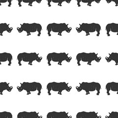 Rhino seamless. Wild animal wallpaper. Stock rhinoceros pattern isolated on white background. Monochrome Vintage hand drawn design
