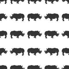 Rhino seamless. Wild animal wallpaper. Stock rhinoceros pattern isolated on white background. Monochrome Vintage hand drawn design