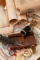 Quill pen, notebook, old papers and vintage items