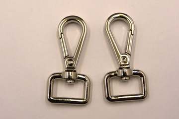 D ring and swivel snap hook set on white background.
