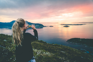 Tourist take a photo of beautful nordic landscape.