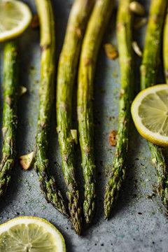 Roasted green asparagus with lemon, pepper, salt and garlic