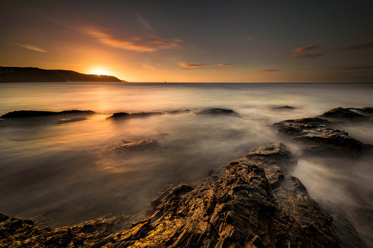 Scenic view of Chapel Rock at sunset, Perranporth, Cornwall, England