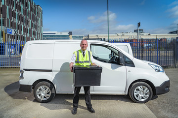 Senior delivery driver with all electric van