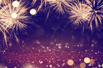 Fototapete - Gold and dark Fireworks and bokeh in New Year eve and copy space. Abstract background holiday.