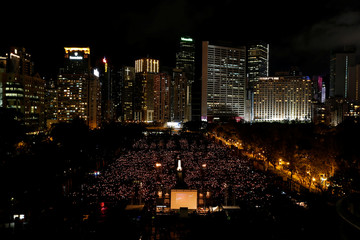 People take part in a candlelight vigil in Hong Kong
