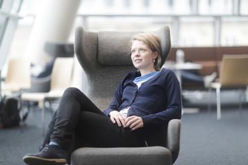 Woman taking break in office