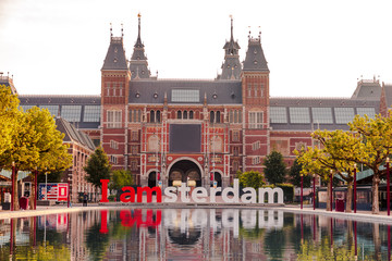 Spoed Fotobehang Amsterdam The sign i amsterdam in front of rijksmuseum in Amsterdam on sunrise