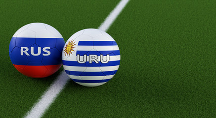 Uruguay vs. Russia Soccer Match - Soccer balls in Uruguays and Russias national colors on a soccer field. Copy space on the right side - 3D Rendering