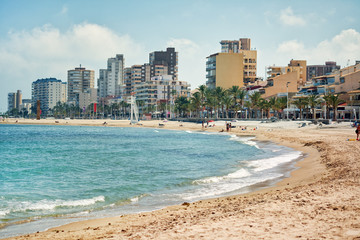 Sandy beach and cityscape El Campello. Alicante, Spain