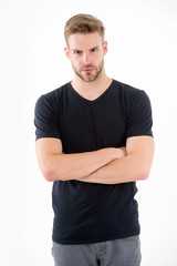 Bearded man with blond hair isolated on white background. Guy with beard on unshaven face. Man in casual tshirt and jeans . Hair care in barber salon or barbershop. Fashion style and trend