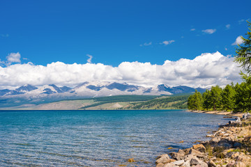 Wild nature of Mongolia. A beautiful view of Lake Hovsgol and the Eastern Sayan Ridge on a sunny summer day