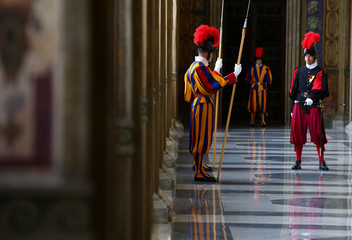 Swiss guards stand guard at the Vatican