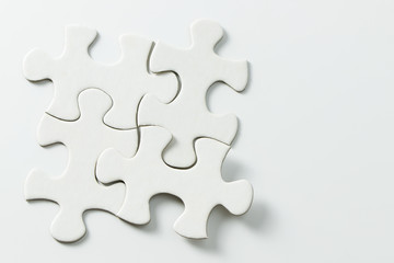 Four pieces of blank white jigsaw puzzle isolated on white background for business conceptual