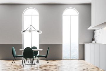 Green chairs dining room interior arched windows