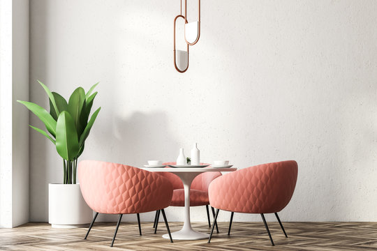 Restaurant interior with pink chairs