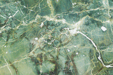 Green marble texture with natural pattern of light and dark veins, for background or tile