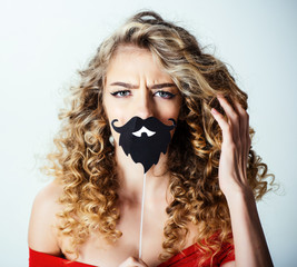 Woman with curly hair. Portrait of funny positive curly hair girl with beard on stick. Makeup and cosmetics for skin care. Beauty and style. Professional hair care. Hairdresser. Barbershop advertising