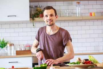 Image of man cooking vegetables on table