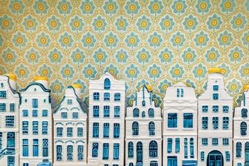 Row of blue miniature souvenir porcelain Amsterdam canal houses