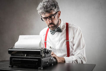 Man using a typewriter