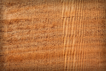 Wooden texture with traces of the saw for background.